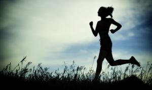 bigstock-Young-woman-running-summer-par-87101918